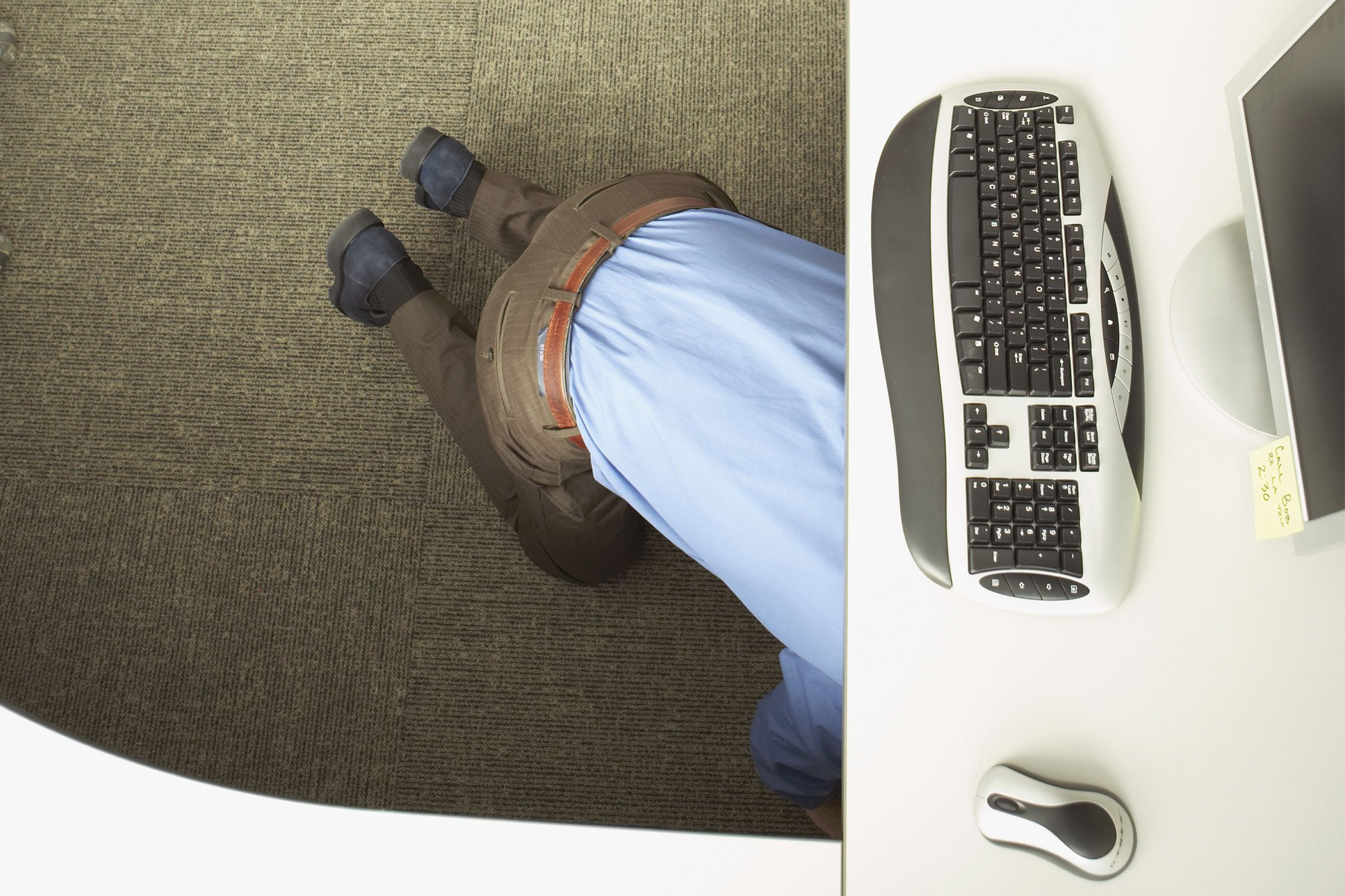 hiding under desk